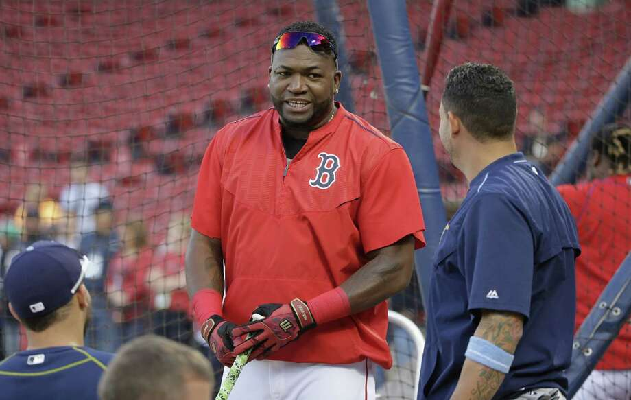 Boston Red Sox DH David Ortiz, center, speaks with members of the Tampa Bay Rays, including Asdrubal Cabrera, right, before Monday's game at Fenway Park. Photo: Steven Senne — The Associated Press  / AP