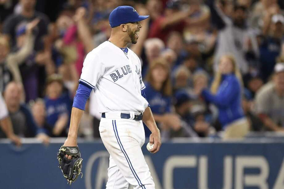 Blue Jays starter David Price struts backwards after catching a pop fly off the bat of New York Yankees catcher Brian McCann during a 4-2 win on Monday in Toronto. Photo: Frank Gunn — The Canadian Press  / The Canadian Press