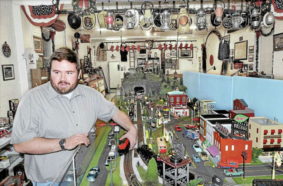 Portland resident Michael Tierney talks about the O gauge model train at the Holiday Toy Train Display at the Connecticut Cellar Savers Fire Museum, 634 Main St., Portland, in this file photo from December 2011. Photo: Middletown Press File Photo  / TheMiddletownPress