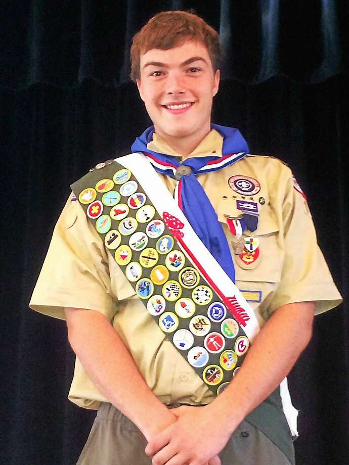 Troop 13 - Boy Scouts of America would like to congratulate Peter Jones of Deep River for earning the rank of Eagle Scout.  An Eagle Scout Court of Honor was held for Peter on Sunday August 16, 2015 at the Deep River Town Hall Auditorium.  To become an Eagle Scout, Peter earned 38 merit badges and advanced through the seven scout ranks by learning Scout and Life skills while simultaneously providing leadership to his Troop and service to his community.  One of the final requirements for the Eagle Rank is to show leadership in and complete a service project that benefits the boyís community, school, or religious institution.   Peterís project was to reconstruct a 20 foot long stone wall to enhance the corner of The Deep River Congregational Churchís cemetery along Platt Lane and Essex Street.  The original wall had fallen into disrepair over the years from erosion. The completed wall complements the existing front wall of the cemetery and new plantings were added to the accent and beautify the area.   Completing this project entailed meeting with the church to determine they stone they preferred, securing donations for supplies, designing and overseeing volunteers through the construction and installation of the wall and plantings.  The completed project provides an important service to the residents of Deep River and members of Deep River Congregational Church by improving the look of the area.  Information about Troop 13 - BSA Troop 13 Boy Scouts serves the boys ages 11-18 of Chester and Deep River. The purpose of the Boy Scouts of America is to help young men develop their character and life skills all while having fun. There is much emphasis placed on assisting these young men to develop into strong healthy citizens who will lead our communities and country in the years ahead. The Boy Scout methods help to promote these ideals through the challenge of putting them into practice with the Troop Program. This is done in a way that is both challenging Photo: Journal Register Co.