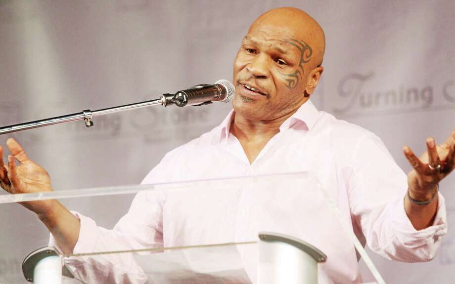 The Associated Press Retired boxer Mike Tyson came to the rescue of an injured motorcyclist after a crash on a Las Vegas interstate last week. Photo: Journal Register Co.