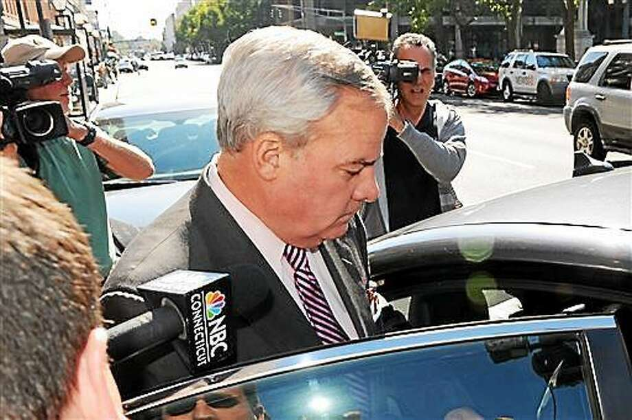 In this file photo, former Gov. John G. Rowland leaves the Federal Courthouse in New Haven Friday, Sept. 19, 2014. Rowland, who resigned from office a decade ago in a corruption scandal, was convicted Friday of federal charges that he conspired to hide payment for work on two congressional campaigns. He was convicted in New Haven federal court of all seven counts, including conspiracy, falsifying records in a federal investigation, causing false statements to be made to the Federal Election Commission and causing illegal campaign contributions. Photo: (AP Photo/The Connecticut Post/Hearst Connecticut Media, Christian Abraham) MANDATORY CREDIT   / The Connecticut Post