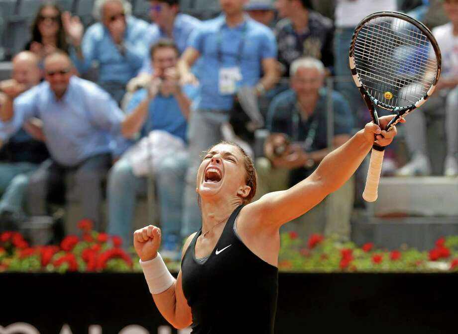 Sara Errani celebrates after winning her quarterfinal match against Li Na at the Italian Open in Rome on May 16. Photo: Alessandra Tarantino — The Associated Press  / AP