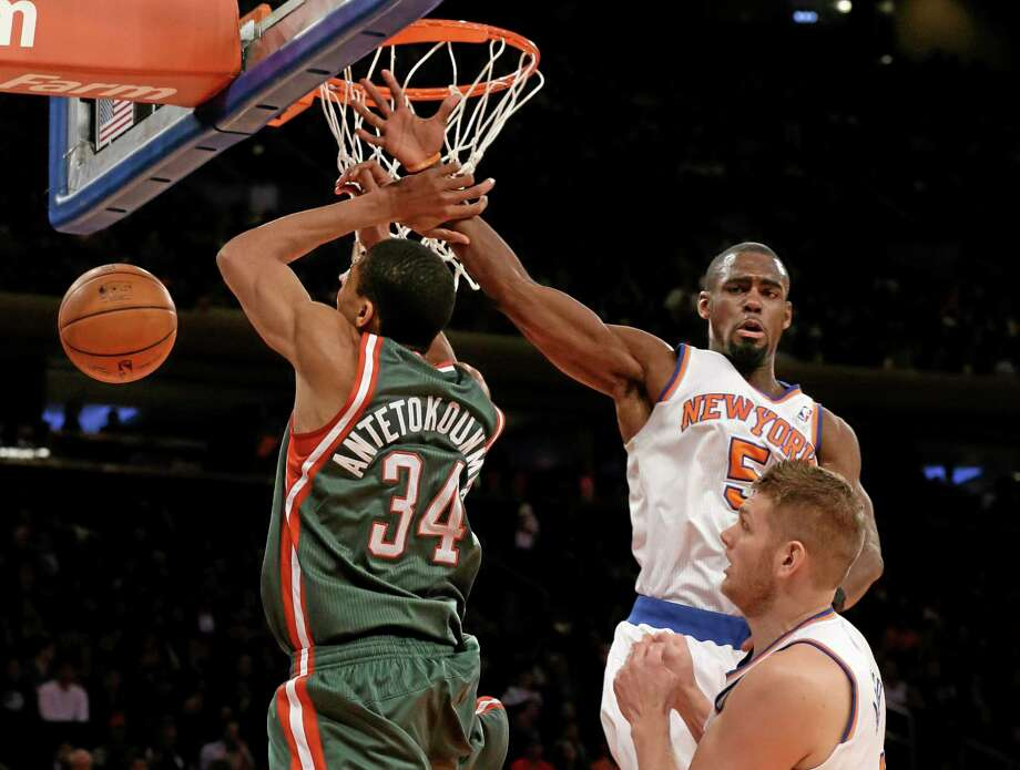 The Milwaukee Bucks' Giannis Antetokounmpo has his shot blocked by the Knicks' Tim Hardaway Jr. during a March 15 game at Madison Square Garden in New York. Photo: Richard Drew — The Associated Press File Photo  / AP