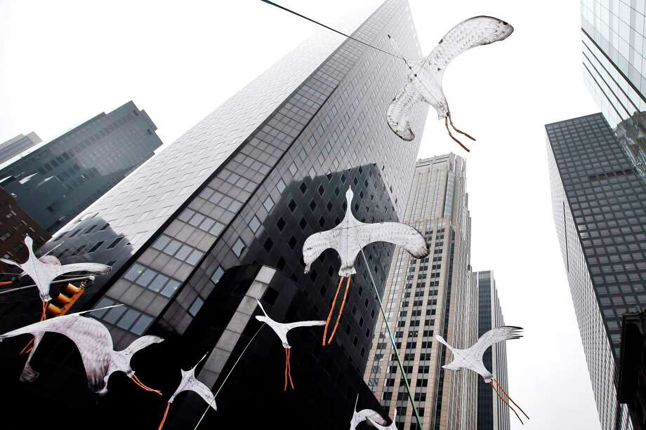 Bird-shaped kites are held in the air as demonstrators make their way down Sixth Avenue during the People's Climate March, Sunday, Sept. 21, 2014, in New York. The march, along with similar gatherings scheduled in other cities worldwide, comes two days before the United Nations Climate Summit, where more than 120 world leaders will convene for a meeting aimed at galvanizing political will for a new global climate treaty by the end of 2015. Photo: AP Photo/Jason DeCrow  / FR103966 AP