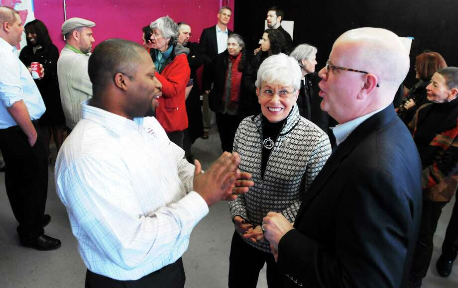 (Photo by Peter Hvizdak ó New Haven Register) Democrat Gary Holder-Winfield, a State Senate candidate for the seat left open when Toni Harp became Mayor of New Haven, left, speaks with Lieutenant Governor Nancy Wyman and Comptroller Kevin Lembo at the grand opening of Holder-Winfield's campaign headquarters Saturday  afternoon January 25, 2014 at 117 Whalley Ave. in New Haven. Photo: New Haven Register / ©Peter Hvizdak /  New Haven Register