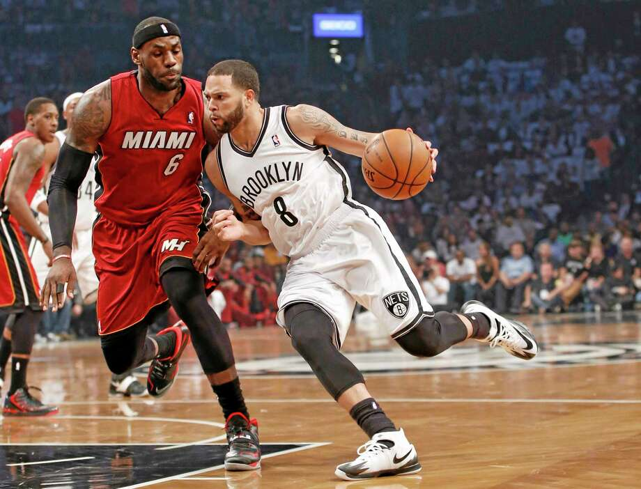 Nets guard Deron Williams drives around Miami Heat forward LeBron James during Game 4 of their second-round playoff series on May 12 in Brooklyn. Photo: The Associated Press  / AP