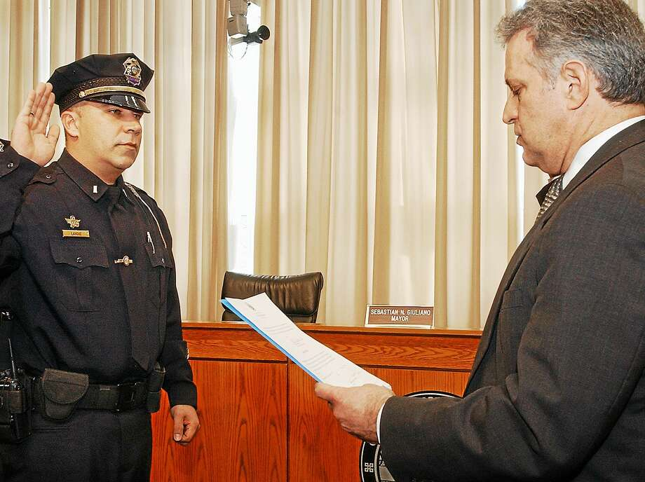 In this photo from January 2010, Middletown Police Lt. Christoper Lavoie is promoted by former Mayor Sebastian N. Giuliano to sergeant at a swearing-in ceremony at city hall. Photo: File Photo