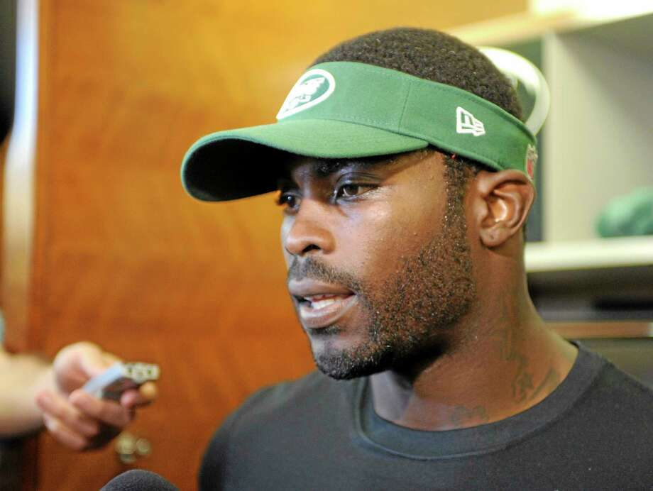 New York Jets quarterback Michael Vick speaks to the media Thursday in Florham Park, New Jersey. Photo: Bill Kostroun — The Associated Press  / FR51951 AP