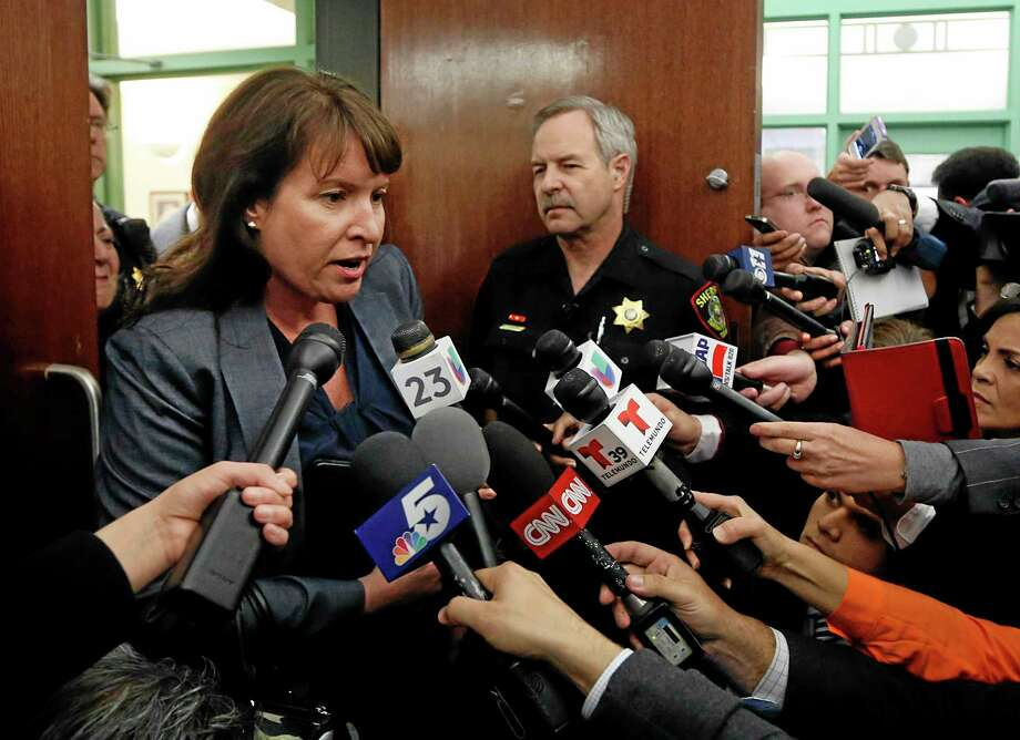 Erick Munoz's attorney Heather King gives a statement outside the courtroom after a judge's ruling in his wife's life or death case at the Tim Curry Criminal Justice Center, Friday, Jan. 24, 2014 in Fort Worth, Texas.  Marlise Munoz is brain dead and on life support with his unborn child at John Peter Smith Hospital. The judge has sided with the family of Marlise Munoz and ordered JPS Hospital to declare the pregnant woman dead and withdraw life support by 5 p.m. Monday.  (AP Photo/The Dallas Morning News, Tom Fox) Photo: AP / The Dallas Morning News