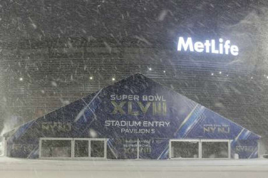 Snow falls over the parking lot of MetLife Stadium in East Rutherford, N.J., where the Super Bowl will be played Feb. 2.