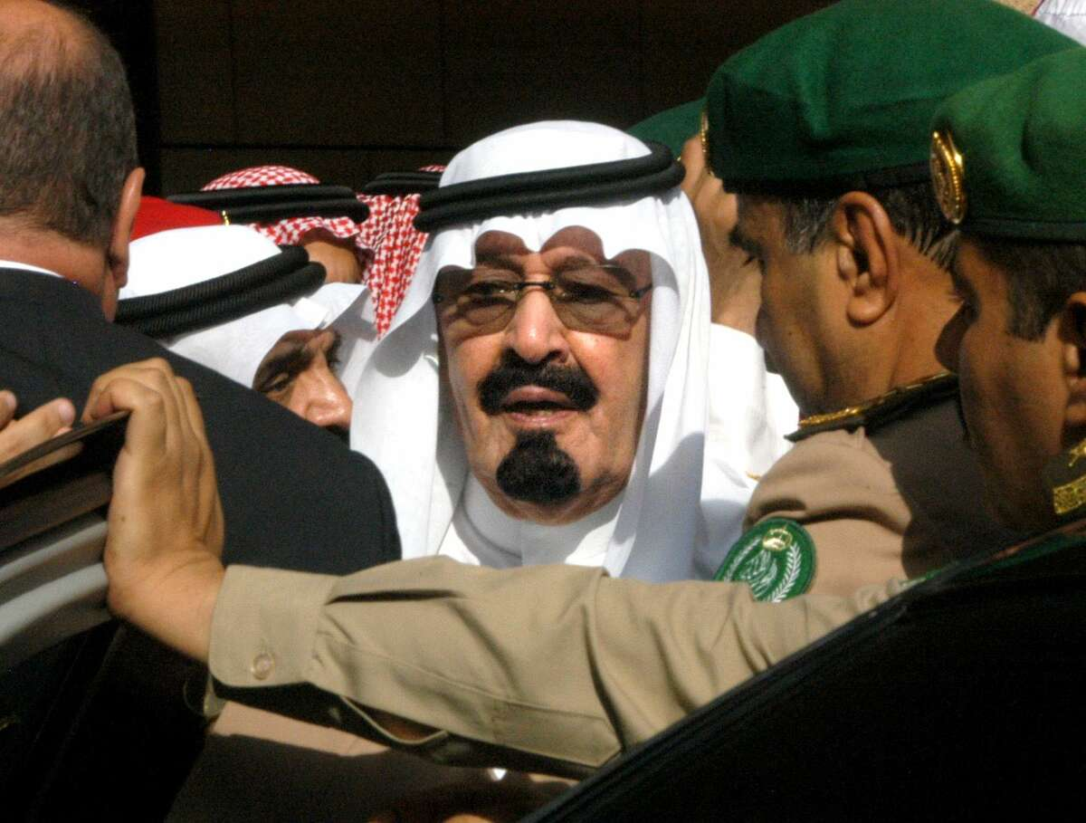 FILE - In this Tuesday, Aug. 2, 2005 file photo, Saudi Arabia's new King Abdullah leaves after special prayers for late King Fahd at Riyadh, Saudi Arabia's Turk bin Abdullah mosque. On early Friday, Jan. 23, 2015, Saudi state TV reported King Abdullah died at the age of 90.