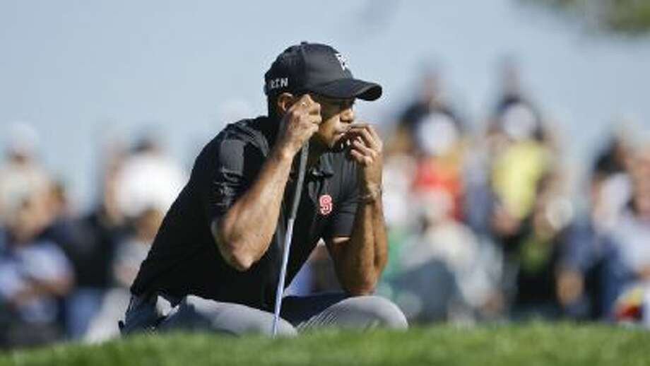Tiger Woods waits his turn on the second green of the South Course at Torrey Pines during the third round of the Farmers Insurance Open Saturday in San Diego.
