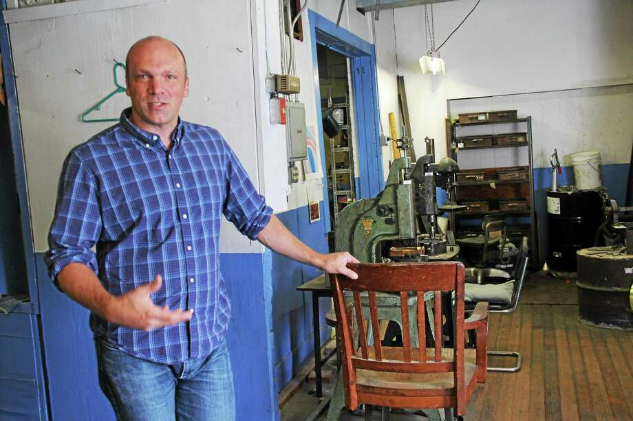 Orion Henderson is a fourth-generation owner of Horton Brasses. The Cromwell company has operated for 150 years. Photo: Kathleen Schassler - Middletown Press  / Kathleen Schassler All Rights