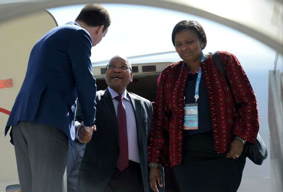 South African President Jacob Zuma, centre left, is welcomed at the airport on his arrival to Moscow, Russia on May 8, 2015. Photo: Host Photo Agency/RIA Novosti Pool Photo Via AP  / HOST PHOTO AGENCY