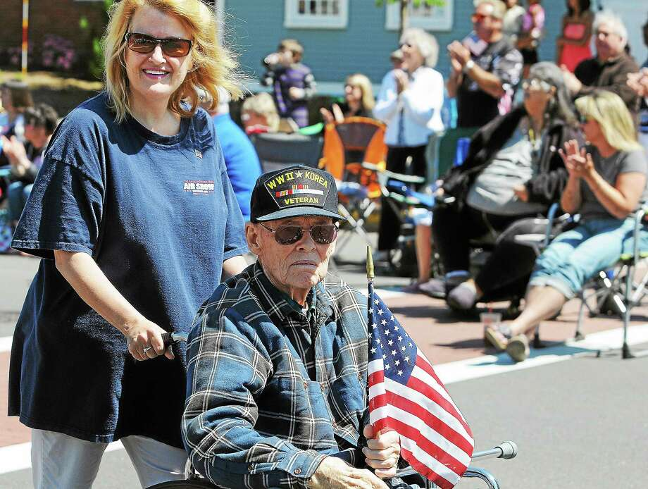 A Middletown veteran is wheeled down Main Street in the Memorial Day Parade in Middletown in 2013. Photo: Andrew Phillip Avalone - Special To The Press  / TheMiddletownPress