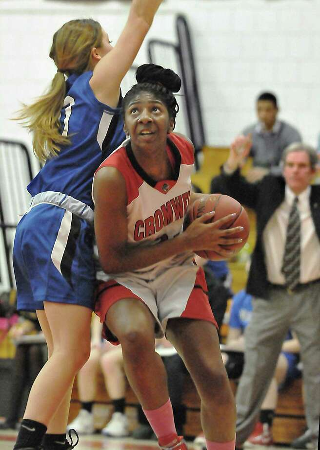 Cromwell senior forward Janelle Harrison drives the baseline as Old Saybrook sophomore guard Bethany Toney defends. Cromwell won 53-31. Photo: Catherine Avalone — The Middletown Press  / TheMiddletownPress