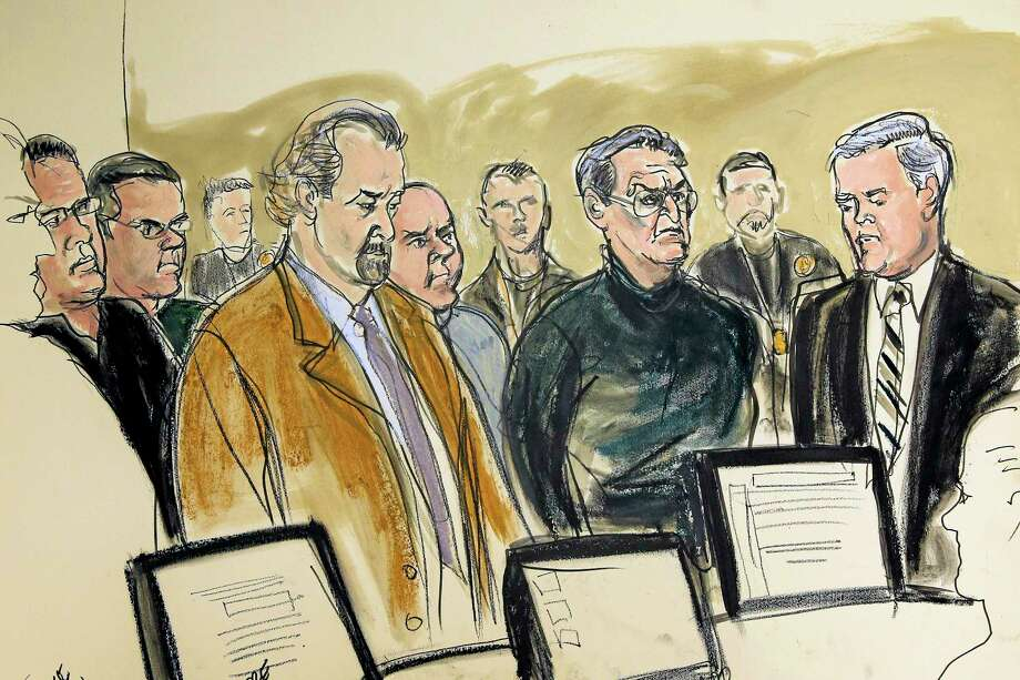 """In this artist's rendering, Jerome Asaro, far left, Jack Bonventre, second from left, defense attorney Charles Hochbaum, third from left, John """"Bazoo"""" Ragano, fifth from left, Vincent Asaro, third from right, and defense attorney Gerald McMahon, right, stand before the judge during an arraignment at federal court, Thursday, Jan. 23, 2014, in the Brooklyn borough of New York. Federal prosecutors issued a wide-ranging indictment against five defendants, alleging murder, robbery, extortion, arson and bookmaking. One of them, Vincent Asaro, of Howard Beach in Queens, was accused of participating in the Dec. 11, 1978, heist ó one of the largest cash thefts in American history. (AP Photo/Elizabeth Williams) Photo: AP / FR 142054AP"""
