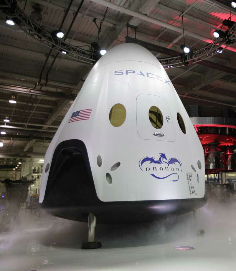 In this May 29, 2014 photo, the SpaceX Dragon V2 spaceship is unveiled at its headquarters in Hawthorne, Calif. Photo: AP Photo/Jae C. Hong, File  / AP