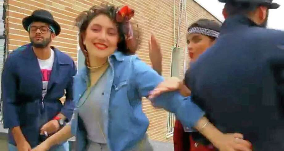 """In this frame grab taken from video posted to YouTube, people dance to Pharrell Williams' hit song """"Happy"""" on a rooftop in Tehran, Iran. Police in Iran have arrested six young people and shown them on state television for posting the video. While the song has sparked similar videos all over the world, in Iran some see the trend as promoting the spread of Western culture. And women are banned from dancing in public or appearing outside without the hijab in the Islamic Republic. (AP Photo) Photo: AP / AP"""