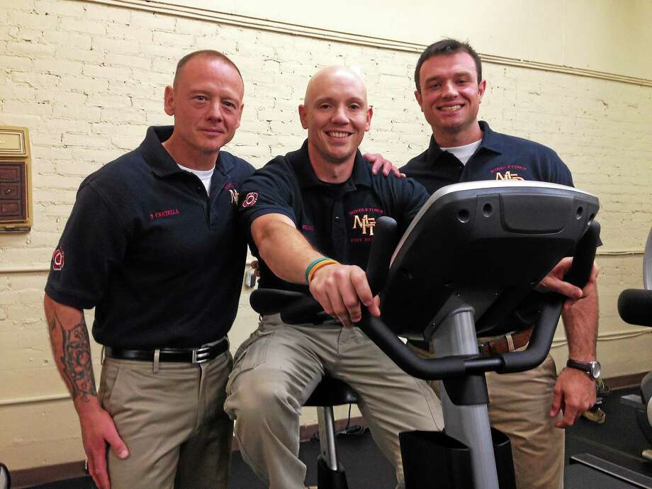 Sal Cretella, Joel Gillooly and Nick Mayo try out an exercise bike Thursday at the new Captain Joe's Gym for Middletown Fire Department firefighters at 515 Main St. Photo: Kaitlyn Schroyer - The Middletown Press
