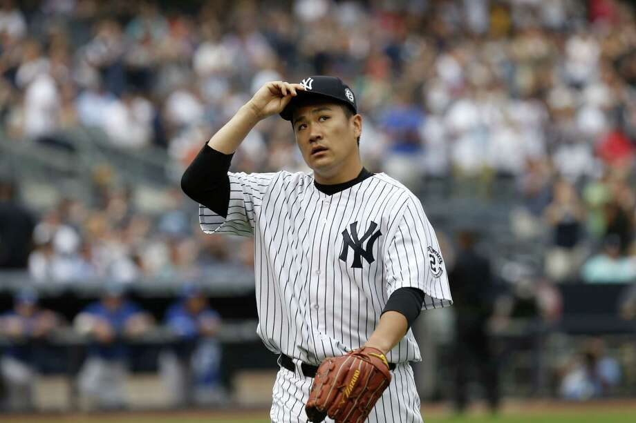 Yankees starting pitcher Masahiro Tanaka tips his cap as he leaves the game during the sixth inning Sunday. Photo: Seth Wenig — The Associated Press  / AP