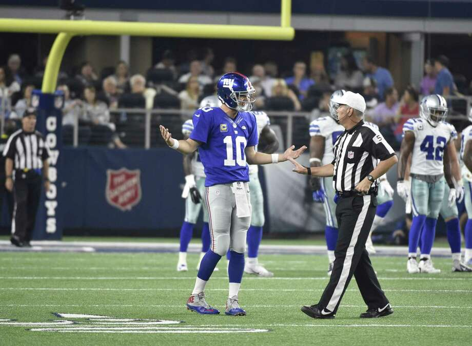 New York Giants quarterback Eli Manning argues with a referee during last Sunday night's game against the Dallas Cowboys in Arlington, Texas. Photo: Michael Ainsworth — The Associated Press  / FR171389 AP