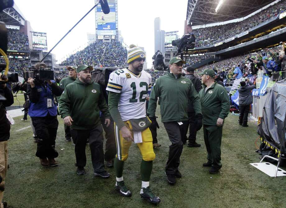 In this Jan. 18 file photo, Green Bay Packers quarterback Aaron Rodgers walks off the field after losing 28-22 in the NFC championship game against the Seahawks in Seattle. Photo: Jeff Chiu — The Associated Press File Photo  / AP