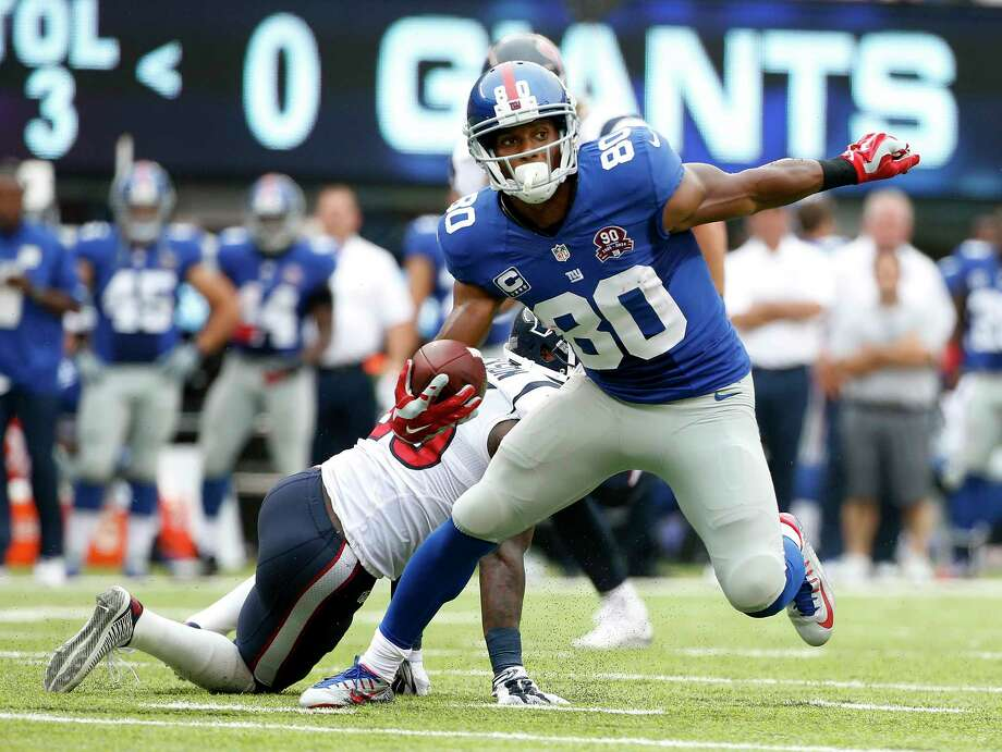 Giants wide receiver Victor Cruz (80) brings the ball up the field against the Texans Sunday. Photo: Kathy Willens — The Associated Press  / AP