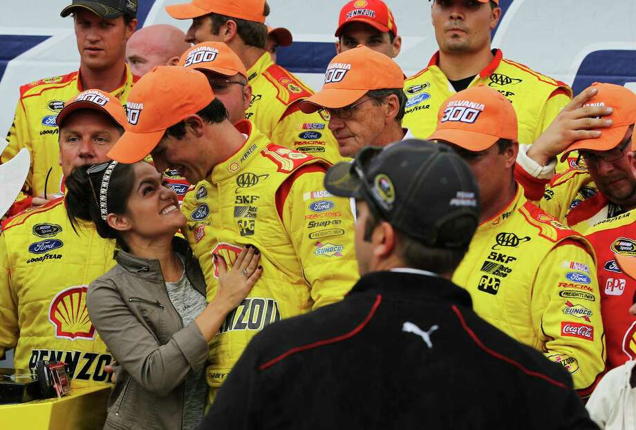 Joey Logano holds the prize lobster as he celebrates in victory lane after winning the Sylvania 300 at New Hampshire Motor Speedway on Sunday. Photo: Cheryl Senter — The Associated Press  / FR62846 AP
