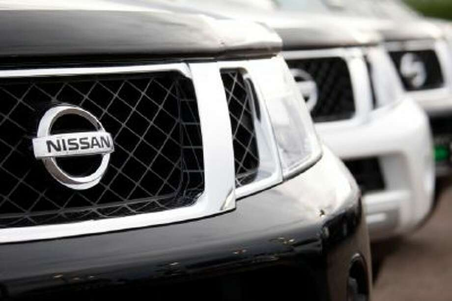 Frontier pickup trucks sit at a Nissan dealership in the southeast Denver suburb of Centennial, Colo.
