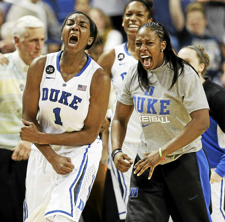 Former Duke stars Chelsea Gray, right, and Elizabeth Williams, left, are now teaming up to try to help lead the Connecticut Sun back to the playoffs. Photo: Chuck Burton — The Associated Press File Photo  / AP2014