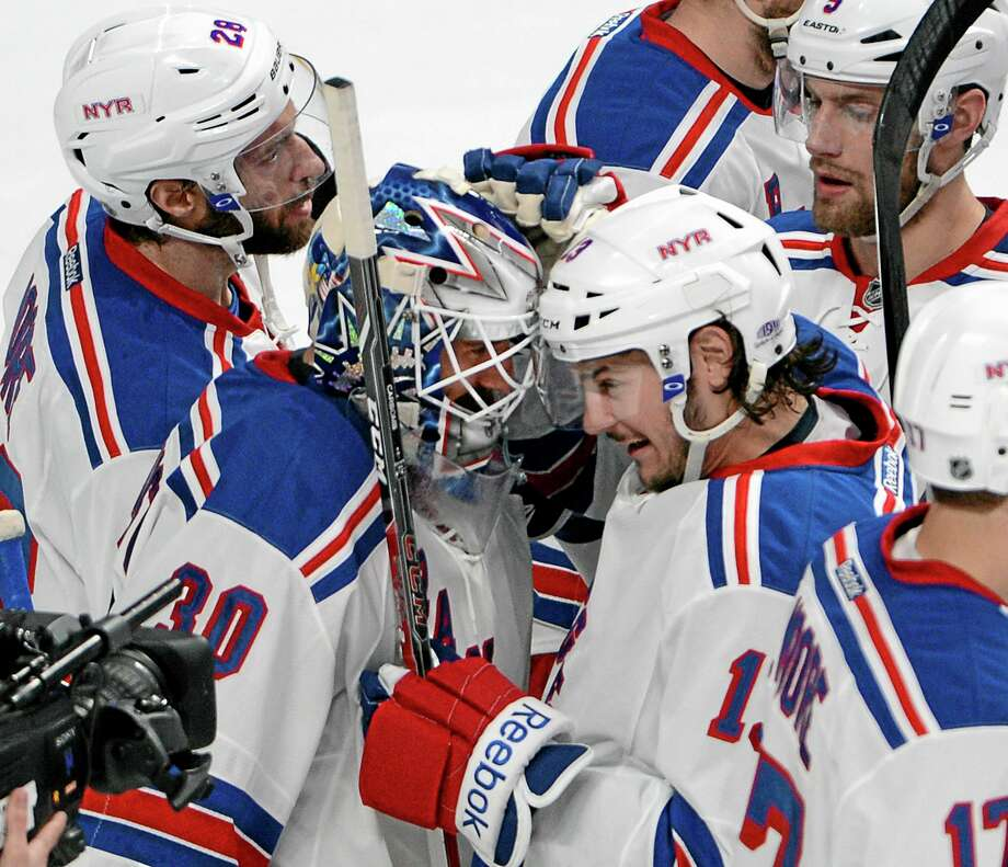 New York Rangers goalie Henrik Lundqvist is congratulated by teammates after defeating the Montreal Canadiens 3-1 in Game 2 of the Eastern Conference finals on Monday in Montreal. Photo: Ryan Remiorz — The Canadian Press  / The Canadian Press