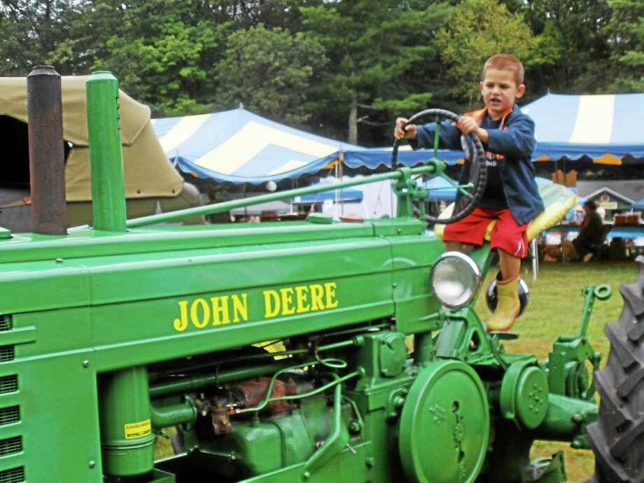 The 41st annual New Hartford Day and Eureka Grange Fair drew nearly 70 vendors with local participation and high turnout despite overcast skies and rainfall. Photo: Stephen Underwood - Special To The Register Citizen