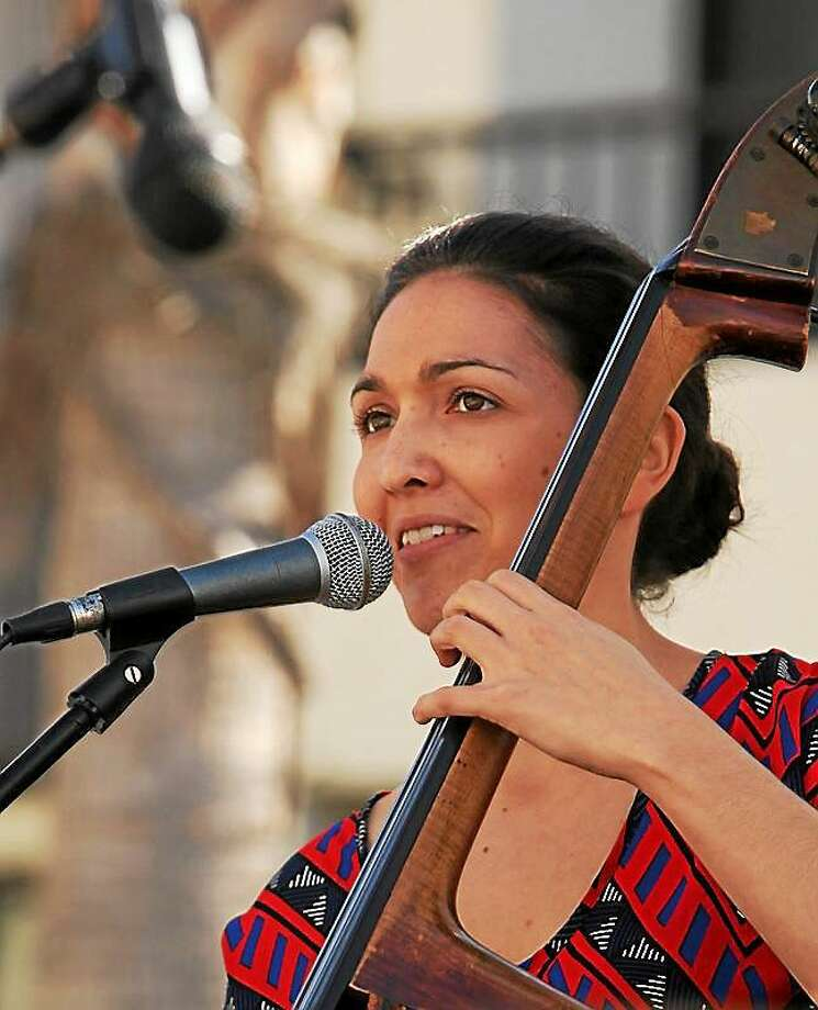 "Photo courtesy of katiethiroux.com Bassist, singer and composer HYPERLINK ""http://www.katiethiroux.com""Katie Thiroux celebrates the release of her debut CD, ""Introducing Katie Thiroux,"" in a concert on Friday, Feb. 6 at HYPERLINK ""http://www.thesidedoorjazz.com""The Side Door in Old Lyme. Photo: Journal Register Co."