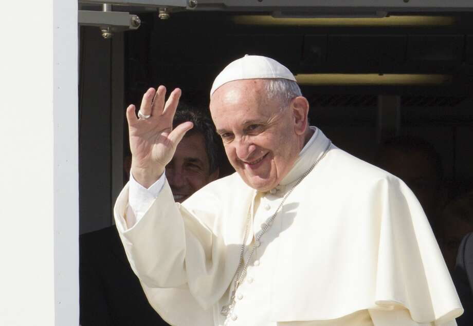 Pope Francis waves to reporters at Rome's Fiumicino international airport Saturday as he boards his flight to La Habana, Cuba, where he will start a 10-day trip including the United States. Photo: Associated Press  / AP