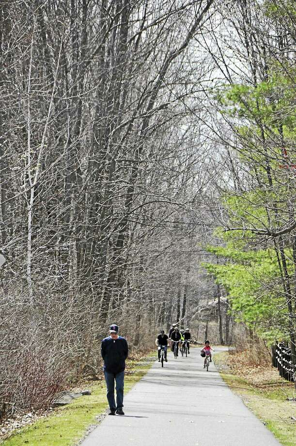Cyclists of all ages share the paved trail with walkers as they ride the Ashuwillticook Trail in Cheshire on Sunday as the warm weather brought many people out to enjoy the outdoors. April, 19, 2015. Gillian Jones — The Berkshire Eagle Photo: Gillian Jones — The Berkshire Eagle