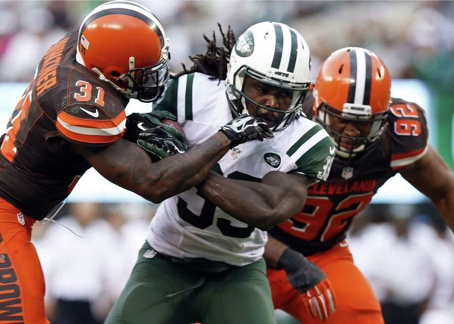 New York Jets running back Chris Ivory (33) ran for 91 yards and two touchdowns on 20 carries in the season-opening win over Cleveland. Photo: The Associated Press File Photo  / AP
