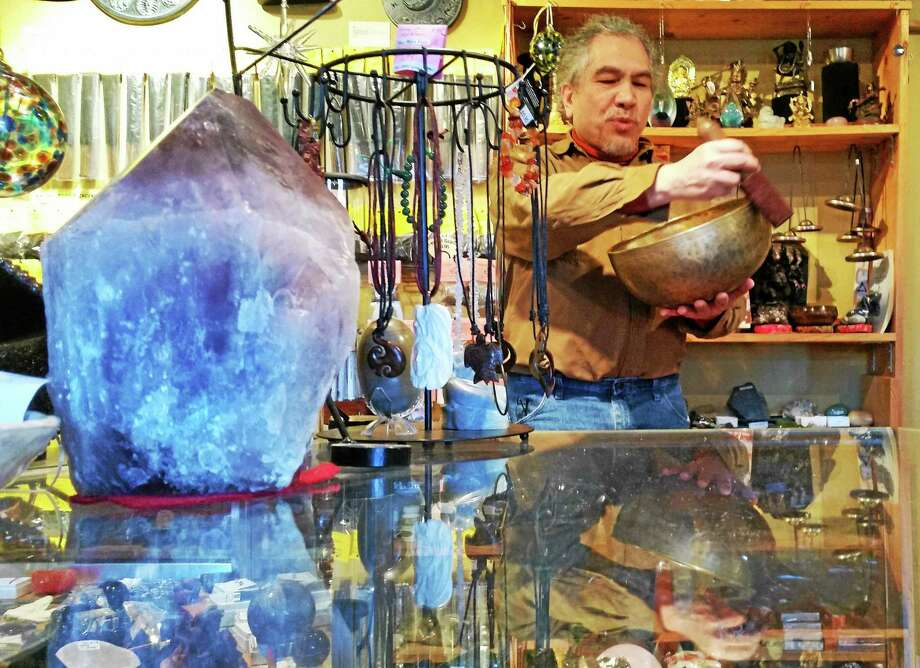 Master percussionist, astrologer and teacher Emile de Leon has owned Middletown's Knight people Books & Gifts at 228 William St. with his wife Melissa for more than 20 years. Photo: Kathleen Schassler — The Middletown Press