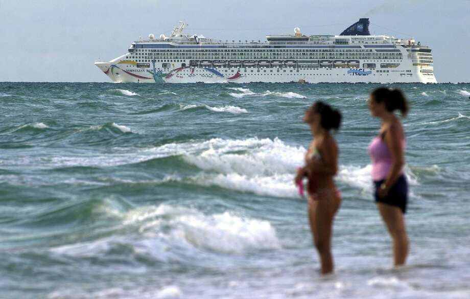 FILE - In this Sept. 1, 2004, file photo, the cruise ship Norwegian Dawn heads out into the Atlantic Ocean from the southern tip of Miami Beach, Fla. An official with Bermuda's Rescue Coordination Center says the ship Norwegian Dawn hit the reef near Bermuda's North Channel, Tuesday, May 19, 2015. The official said the ship is in a stable position. Norwegian Cruise Line said in a brief statement that the ship temporarily lost power and its propulsion was affected but that everyone aboard is safe and that the ship has full power. Photo: (AP Photo/Bill Cooke, File) / AP