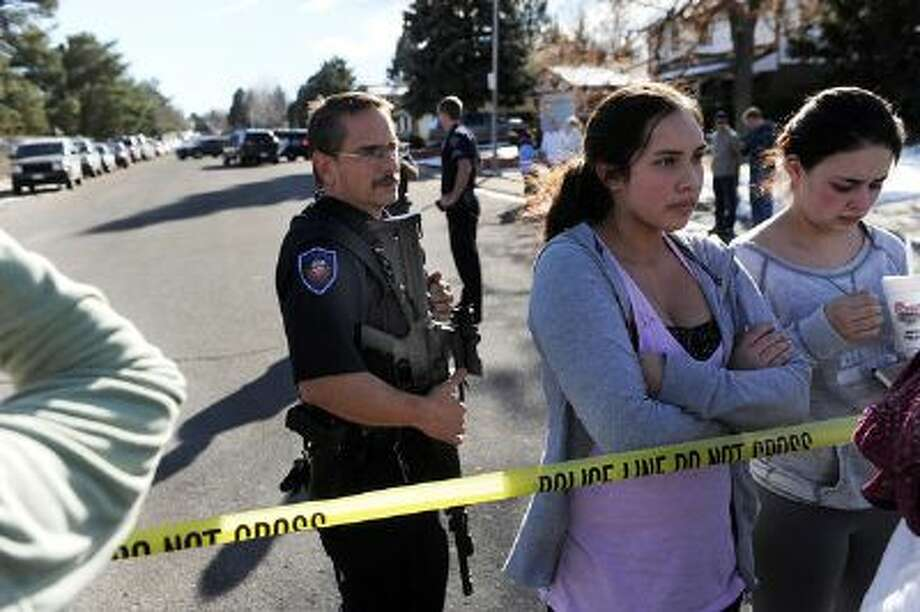 Students were detained inside a perimeter until the situation was less chaotic. Parents waited to be reunited with their children outside Arapahoe High School Friday afternoon, December 13, 2013. A shooting inside the school sent hundreds of students rushing for safety. Photo: DP / Copyright - 2013 The Denver Post, MediaNews Group.