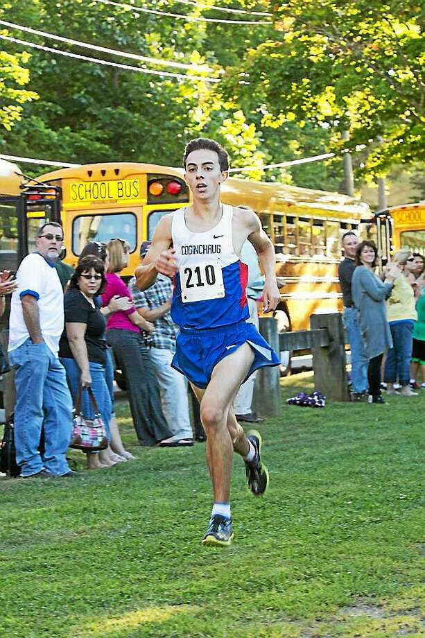Coginchaug senior Christian Alberico won the 27th annual Going to the Sun Invitational on Thursday at Durham. Alberico, shown winning last week's Blue Dragon Invite, placed first in 16:09.89. Photo: Sandy Aldieri — Special To The Press