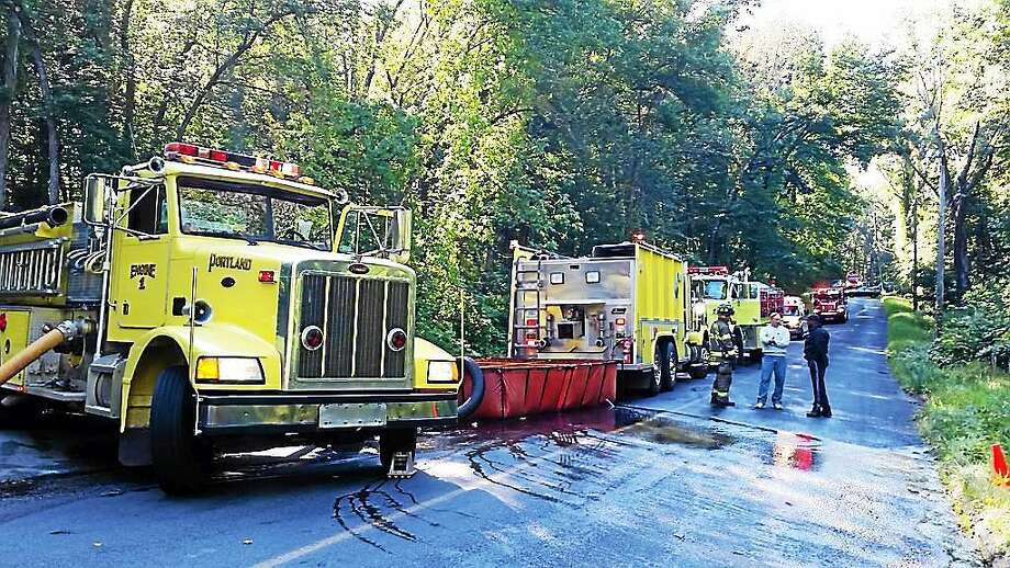 A two-alarm house fire shut down shut down Penfield Hill Road on Friday. In addition to local firefighters, crews from Middletown and East Hampton were called in to help. Photo: KatHLEEN Schassler — THE Middletown Press