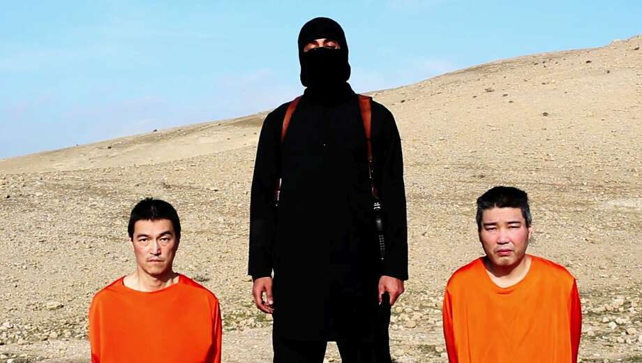 This image taken from an online video released by the Islamic State group's al-Furqan media arm on Jan. 20, 2015, purports to show the group threatening to kill two Japanese hostages that the militants identify as Kenji†Goto Jogo, left, and Haruna Yukawa, right, unless a $200 million ransom is paid within 72 hours. Japan's Foreign Ministry's anti-terrorism section has seen the video and analysts are assessing it, a ministry official said on Tuesday. Photo: AP Photo  / Islamic State group