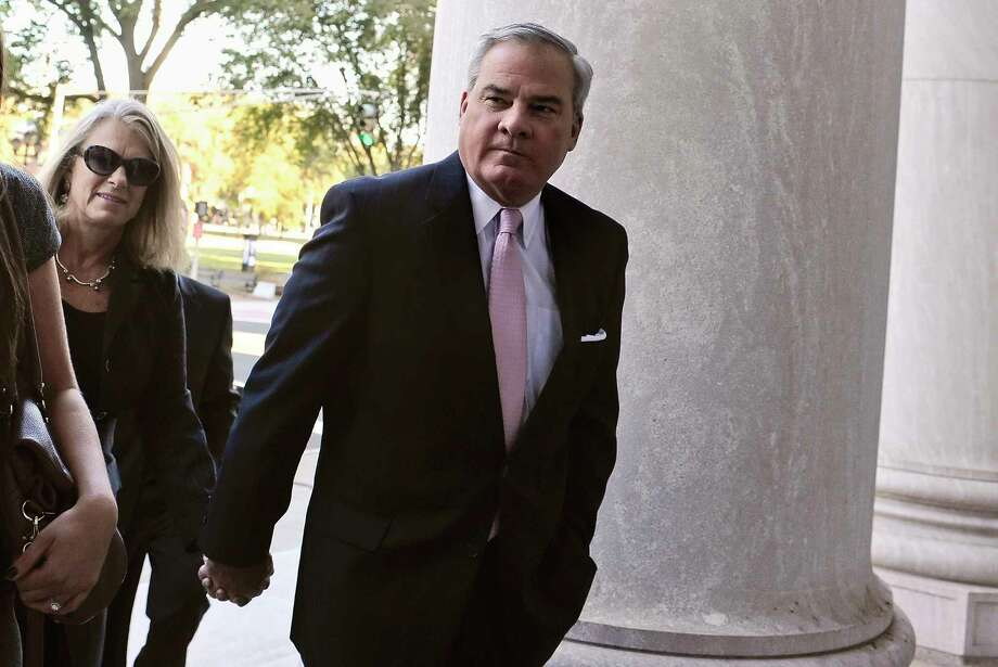 Former Connecticut Gov. John G. Rowland, right, arrives with his wife Patty Rowland at federal court Thursday, Sept. 18, 2014, in New Haven, Conn.  Rowland faces seven federal charges, including allegations he conspired with Apple's owner, Brian Foley, to hide $35,000 in payments for work he did on the 2012 congressional campaign of Foley's wife, Lisa Wilson-Foley. (AP Photo/Jessica Hill) Photo: AP / FR125654 AP