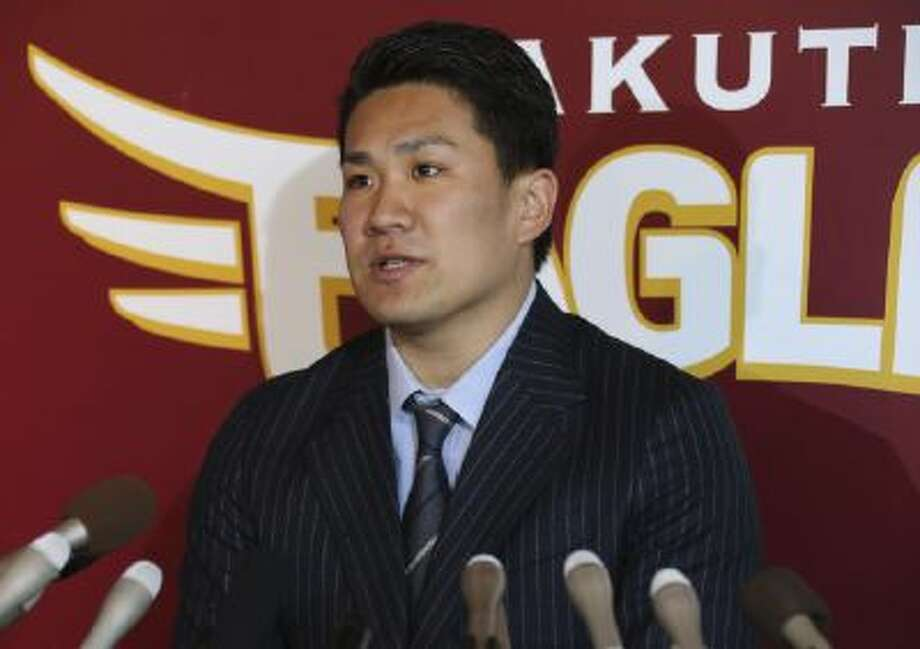 Masahiro Tanaka speaks during a press conference at the Rakuten Golden Eagles' stadium in Sendai, northeastern Japan, Thursday, Jan. 23, 2014.