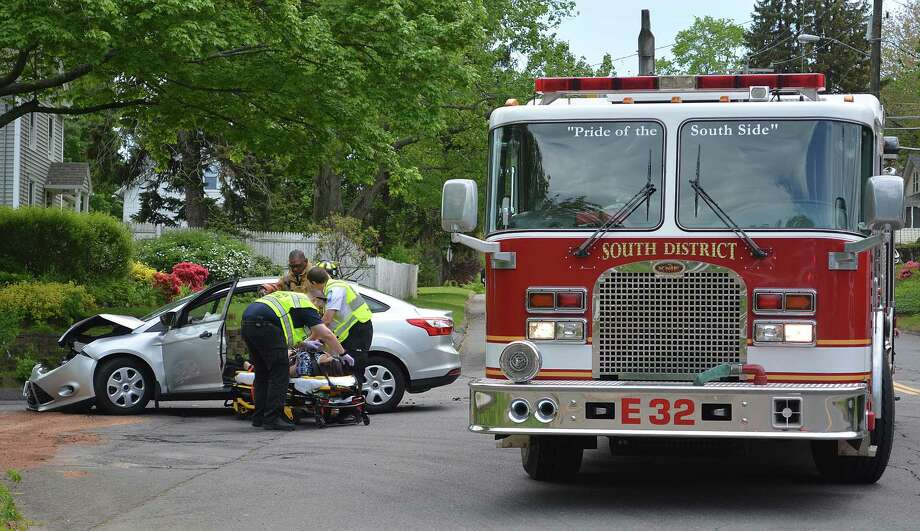 Emergency personnel from Hunter's Ambulance and South Fire District respond to a two-car accident with minor injuries between a Ford Focus and a Toyota Camry at the intersection of Ridge Road and Mill Street in Middletown. Photo: Catherine Avalone — The Middletown Press