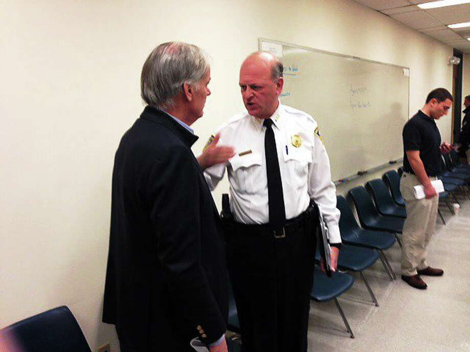 Tom Foley talks to Chief Dean Esserman after the CompStat meeting Thursday. Photo by Rich Scinto/ New Haven Register Photo: Journal Register Co.