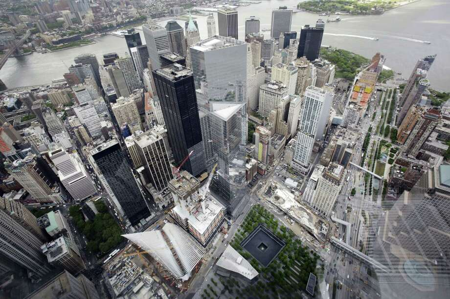 The Financial District and the World Trade Center, lower center, are seen from the observatory at One World Trade Center, Wednesday, May 20, 2015, in New York. The observatory atop the 104-story skyscraper opens to the public on May 29. Photo: (AP Photo/Mark Lennihan) / AP