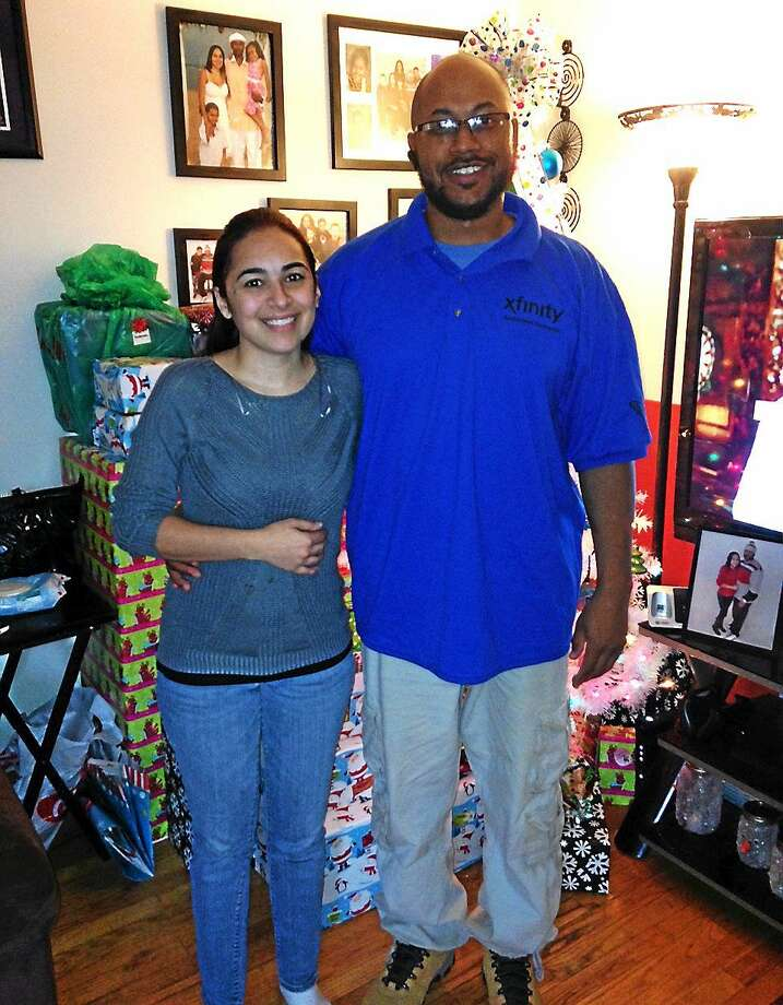 Maribel and Marcus Wynn of Middletown are fostering a girl with hearing issues. Photo: Christopher Pace